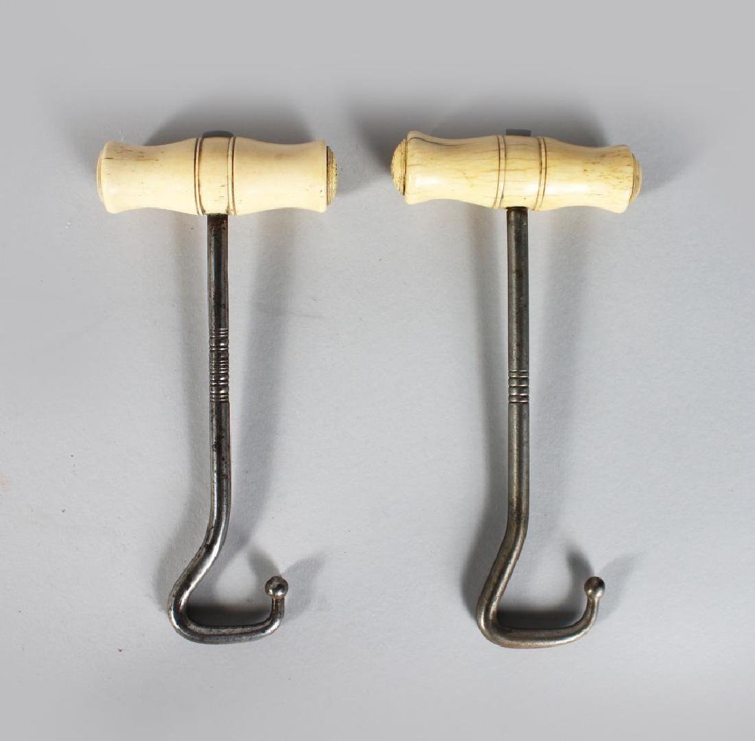 A PAIR OF LONG HANDLED BOOT PULLS
