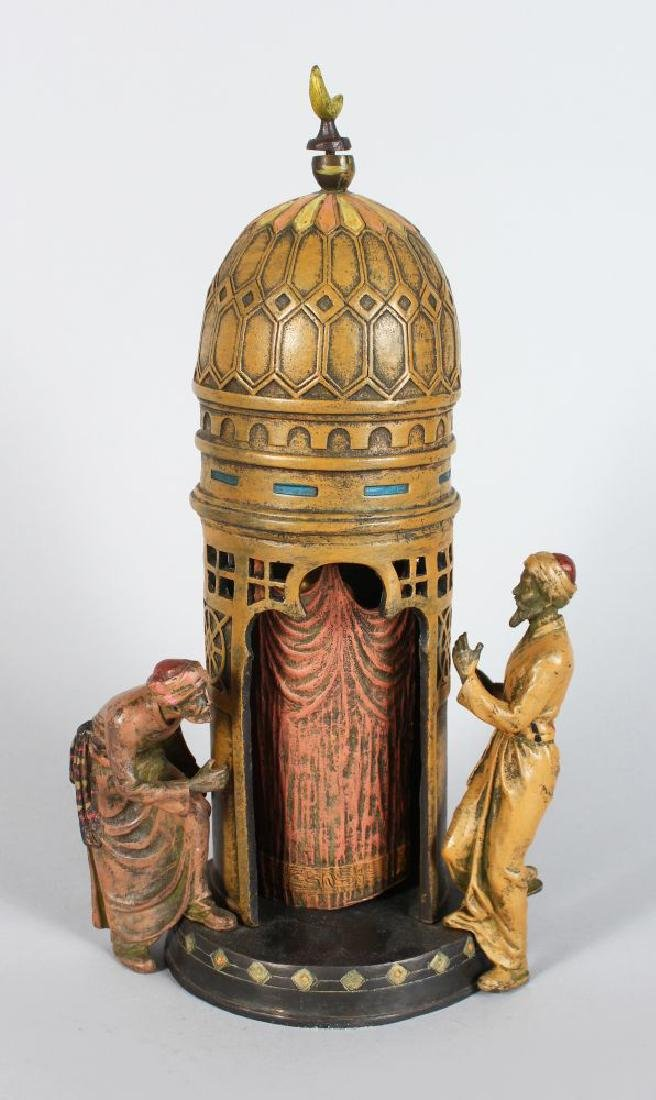 AN AUSTRIAN COLD PAINTED TEMPLE, with two arabs,