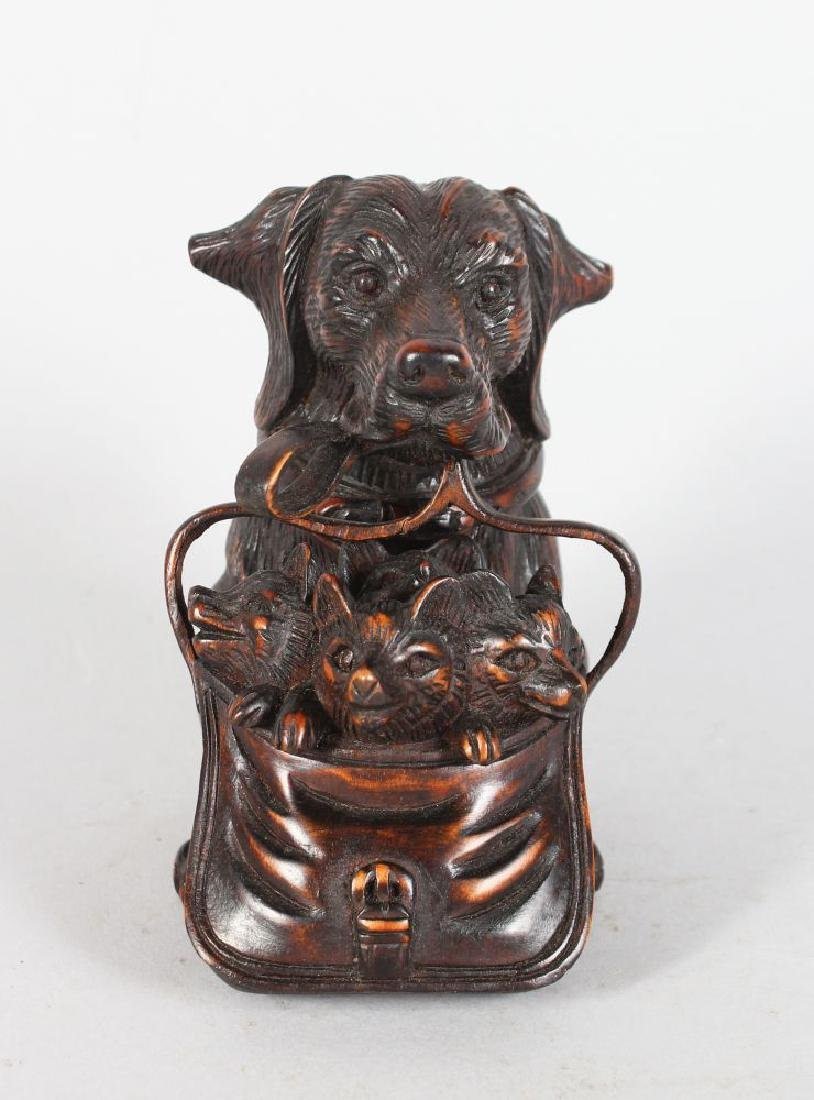 "A SMALL ""BLACK FOREST"" CARVED WOOD DOG INK WELL, with"