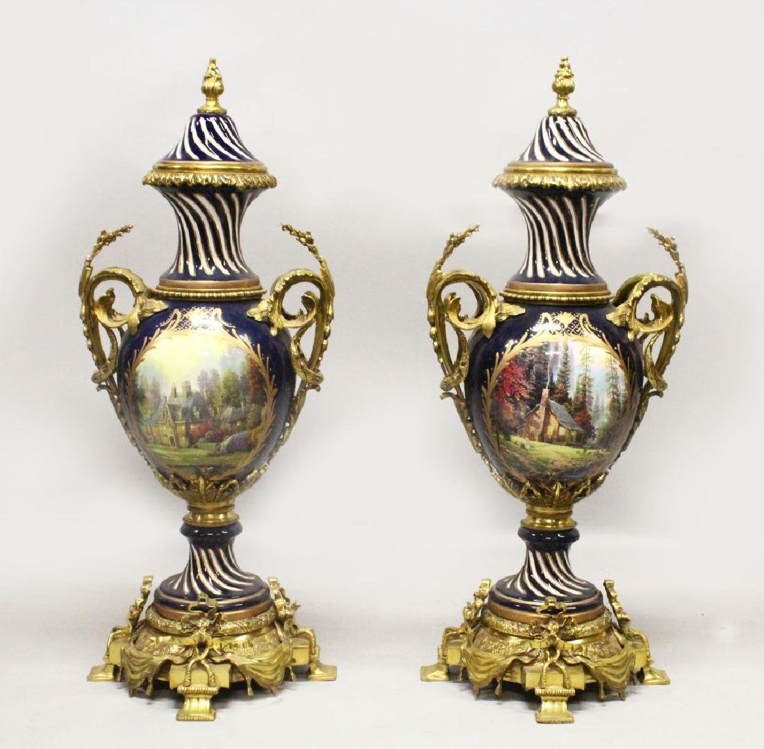 A LARGE PAIR OF SEVRES STYLE PORCELAIN VASES WITH