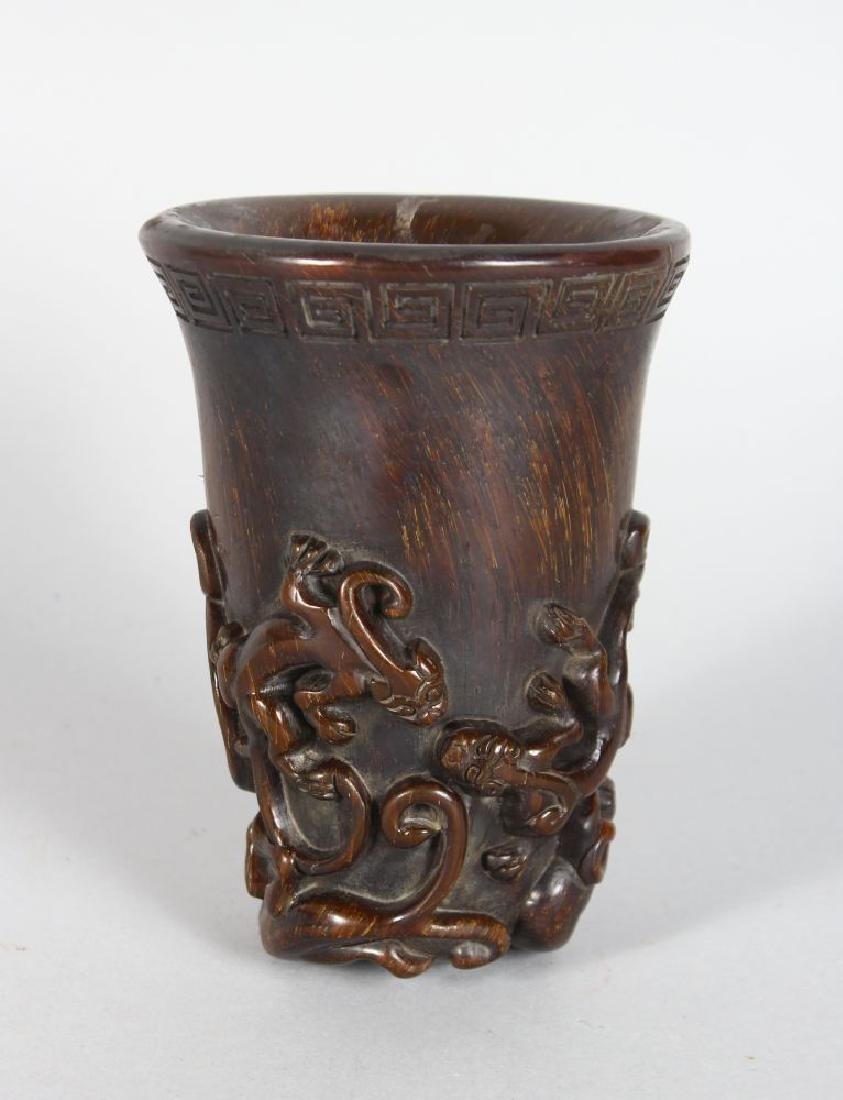 A CHINESE HORN LIBATION CUP, carved with Chih Long.