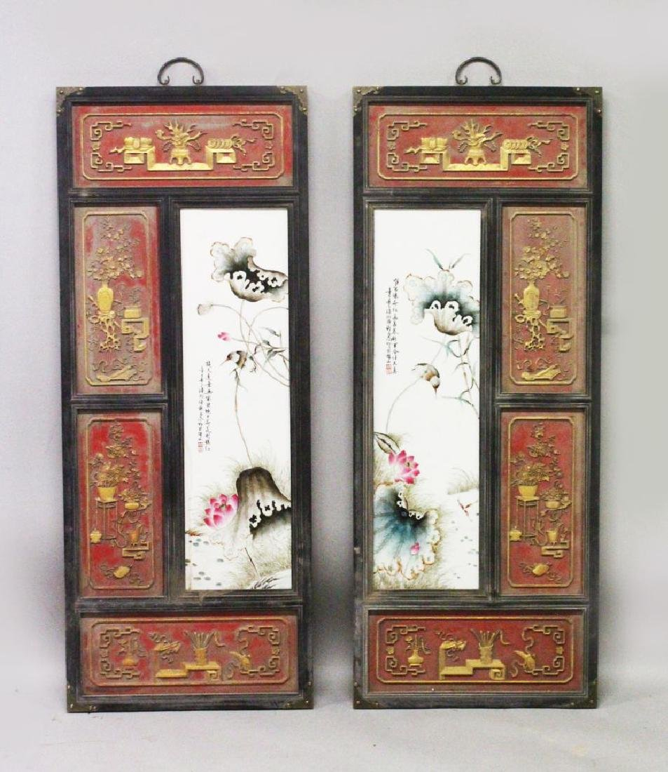 A PAIR OF CHINESE CARVED WOOD HANGING PANELS, inset