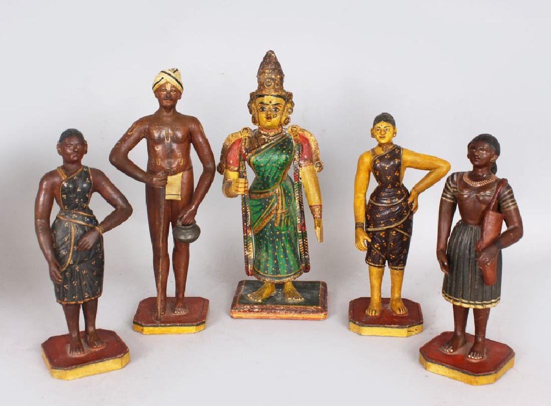 A GROUP OF FIVE INDIAN STUCCO CARVED WOOD AND PAINTED