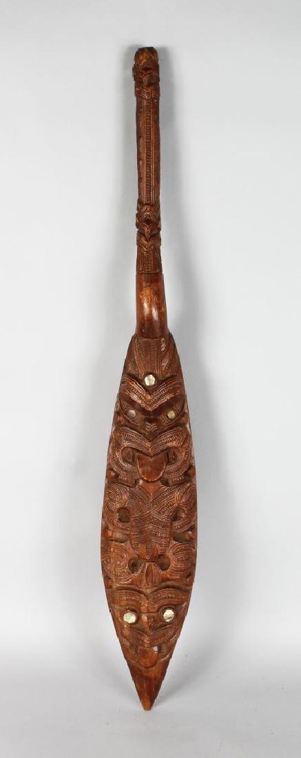 MAORI DANCE PADDLE  Wood, paua shell,  Slender form