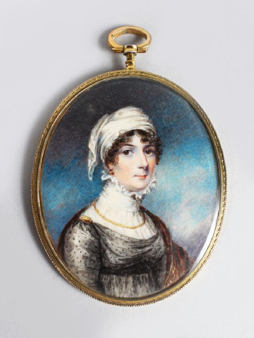 A GOOD OVAL PORTRAIT OF A LADY, wearing a white head