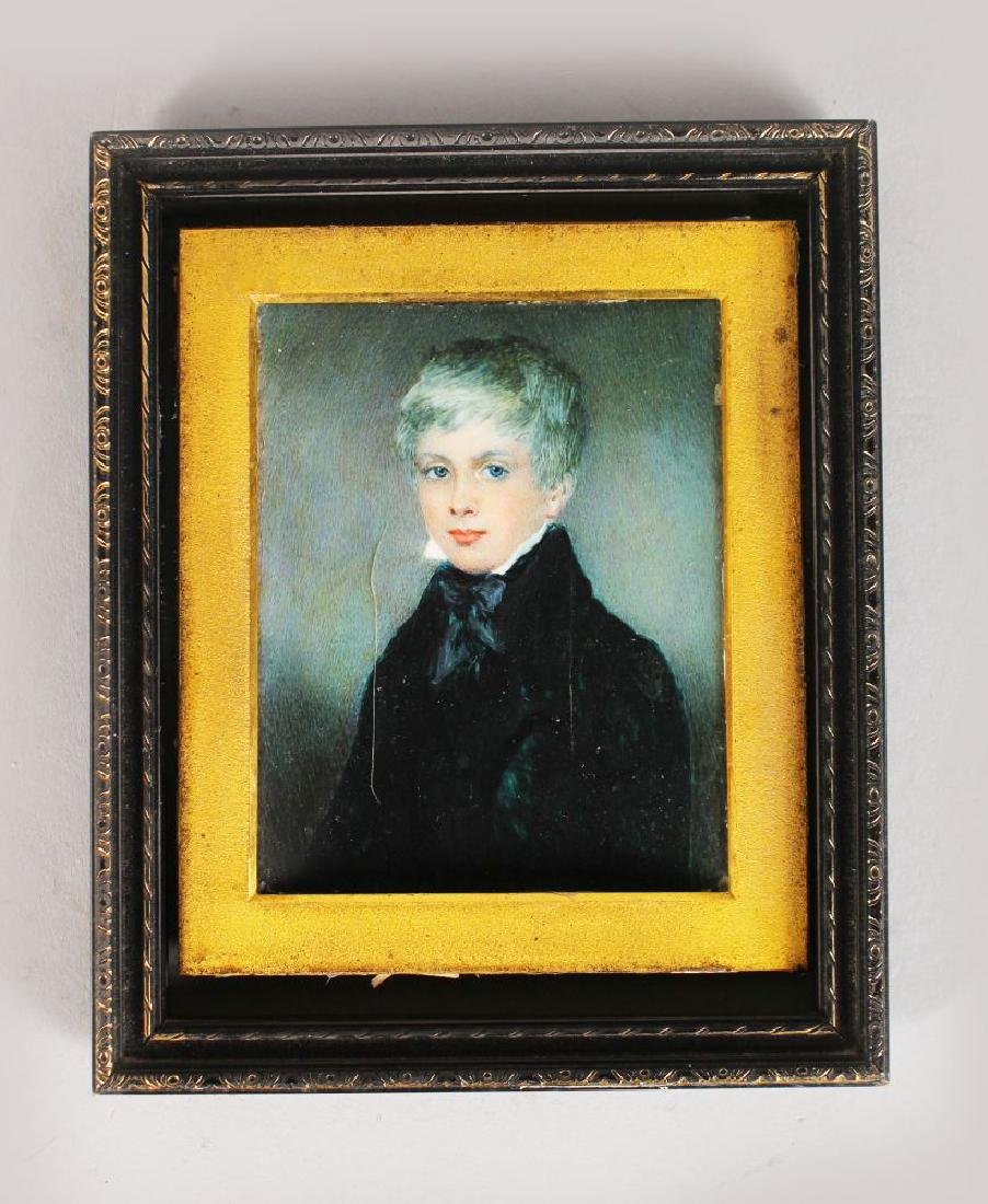 A MINIATURE OF A YOUNG BOY, with black cravat and coat
