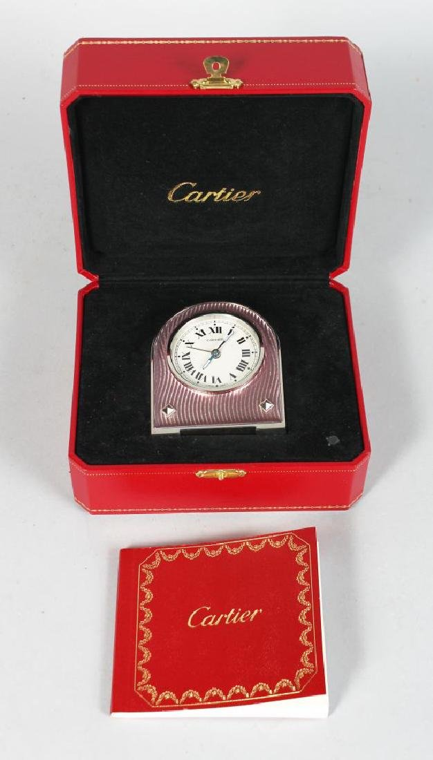 A GOOD CARTIER TABLE CLOCK, in orginal red leather box