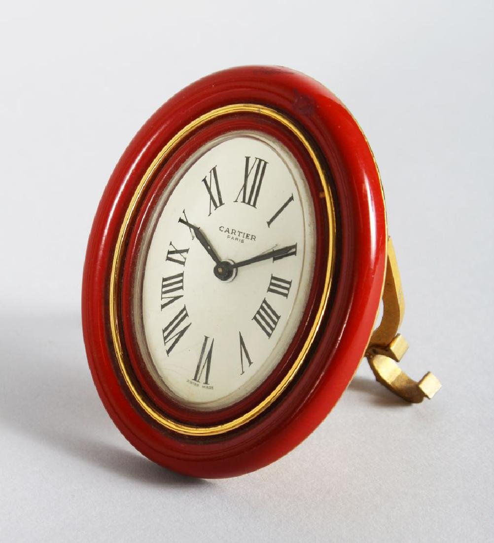 A CARTIER OF PARIS OVAL EASEL CLOCK, 3.5in x 2.25in. in