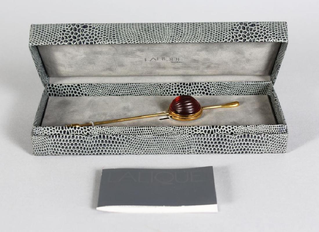 A LALIQUE NERITA STICK PIN AND PENDANT, in a Lalique