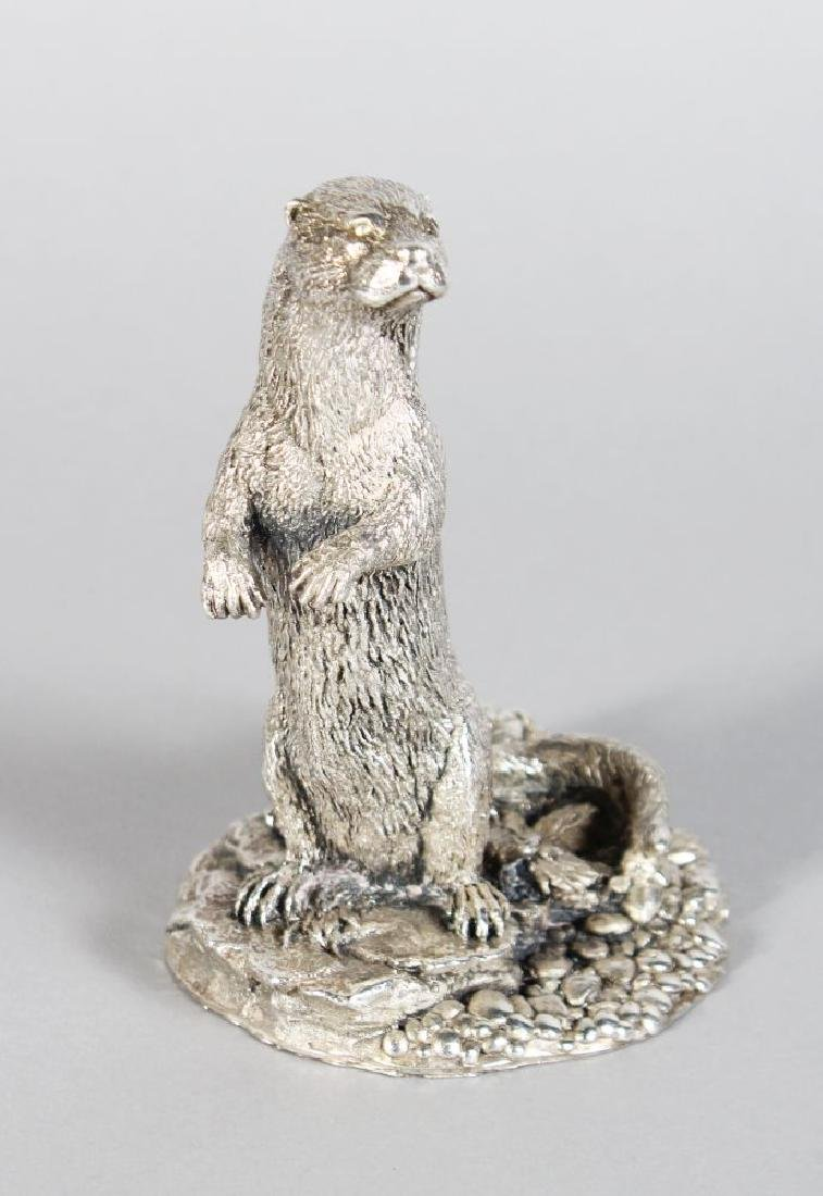 A SILVER MODEL OF AN OTTER