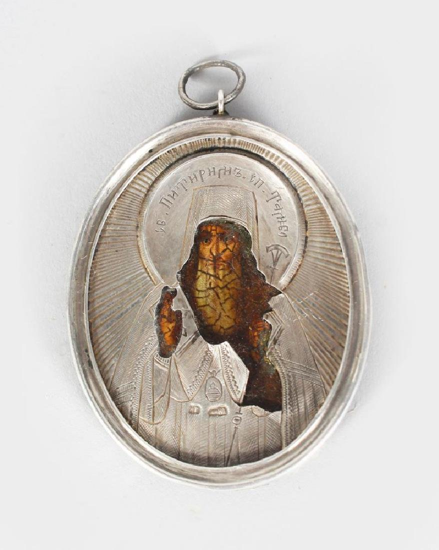 A RUSSIAN SILVER OVAL TRAVELLING ICON, engraved with