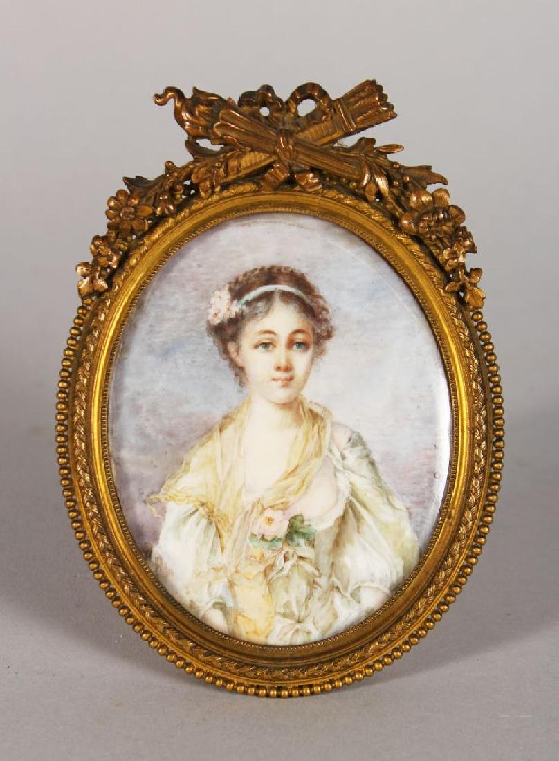 M. ROGE, A LOVELY OVAL PORTRAIT OF A YOUNG LADY, signed