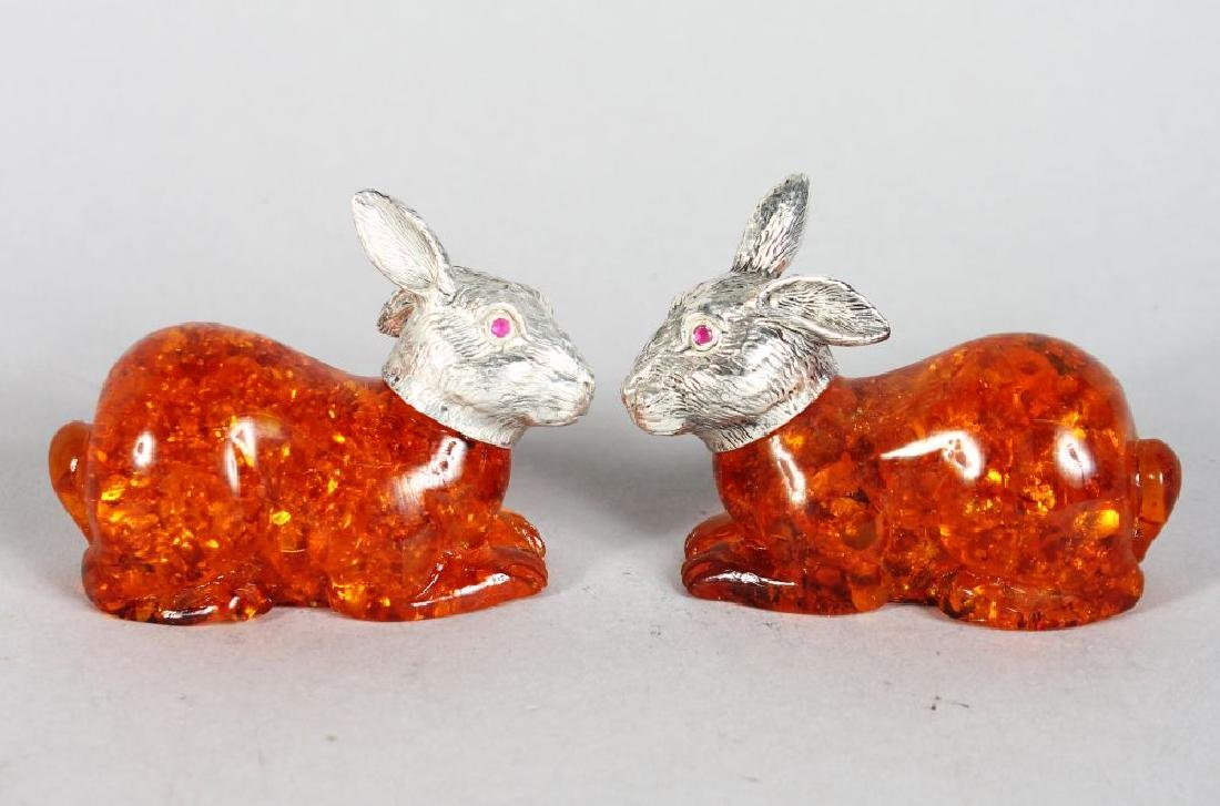 A PAIR OF AMBER STYLE RABBITS