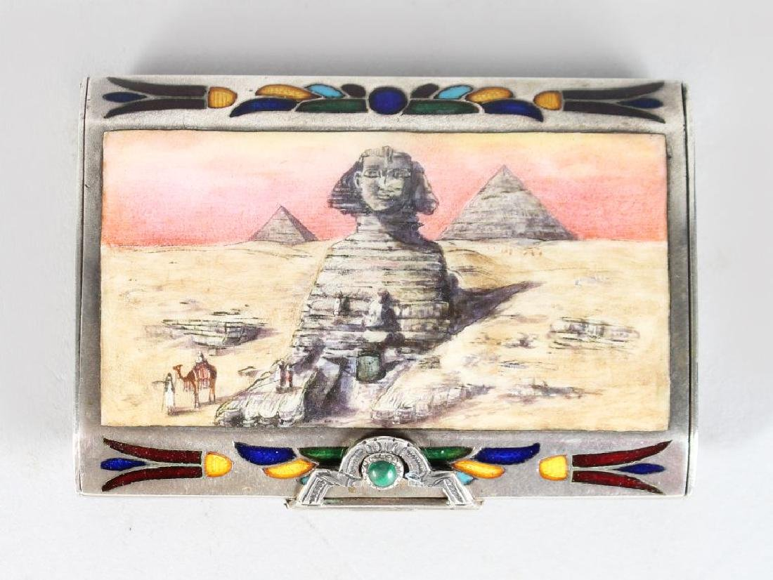 A SILVER AND ENAMEL EGYPTIAN STYLE SNUFF BOX, the lid