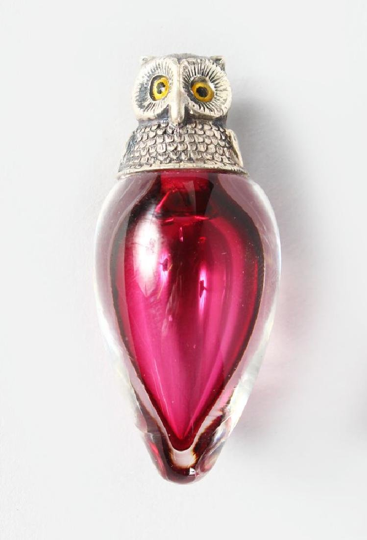 A SILVER NOVELTY CRANBERRY GLASS OWL PERFUME BOTTLE