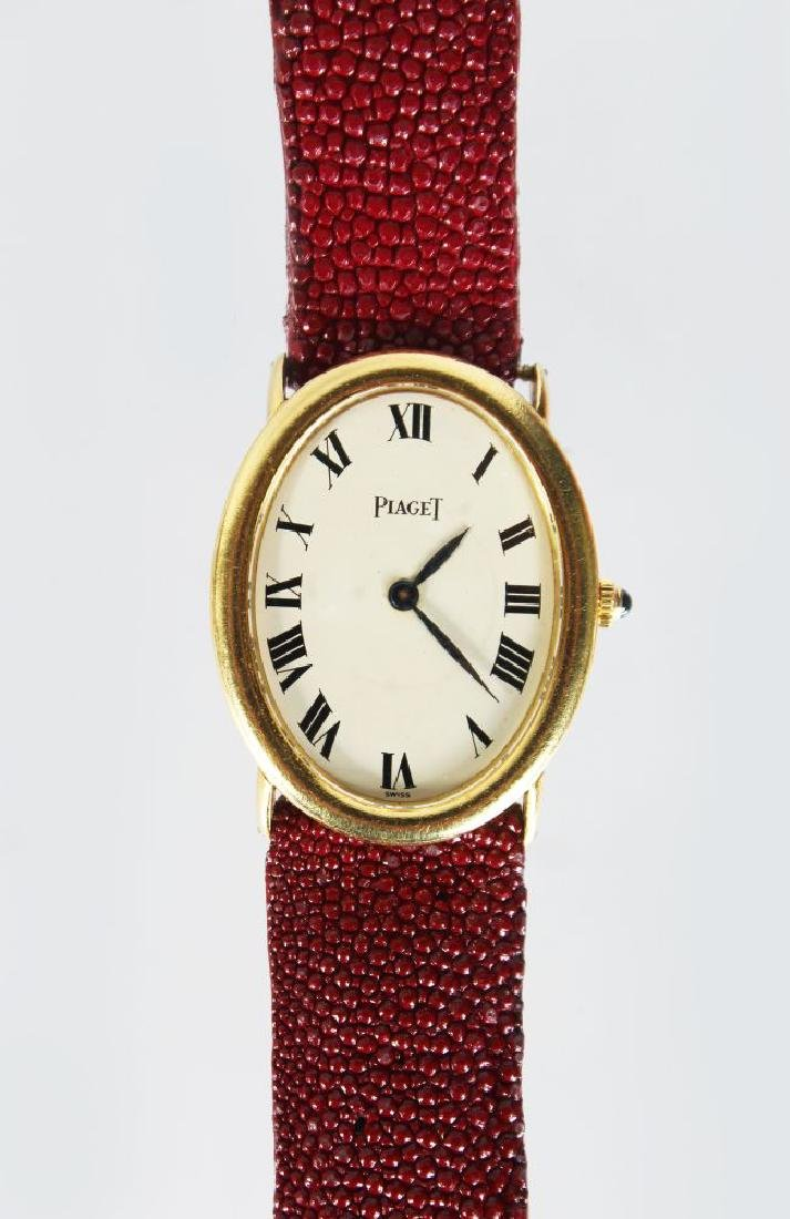 A PIAGET 18ct GOLD WATCH, with leather strap No: