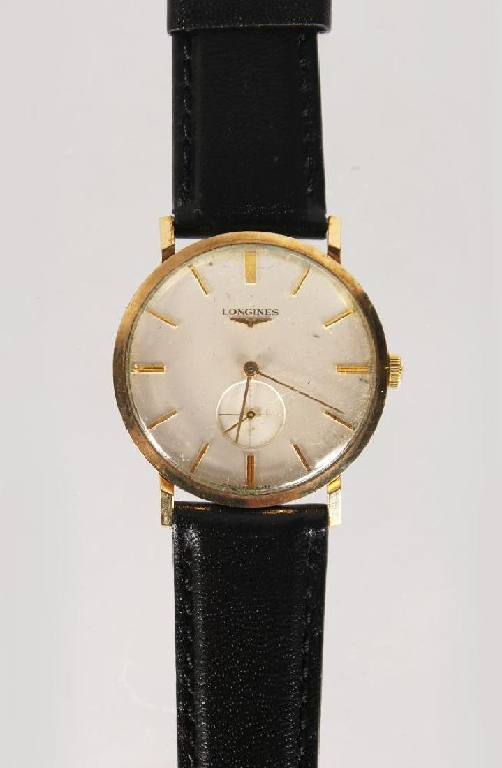 A LONGINES GOLD WATCH with leather strap.