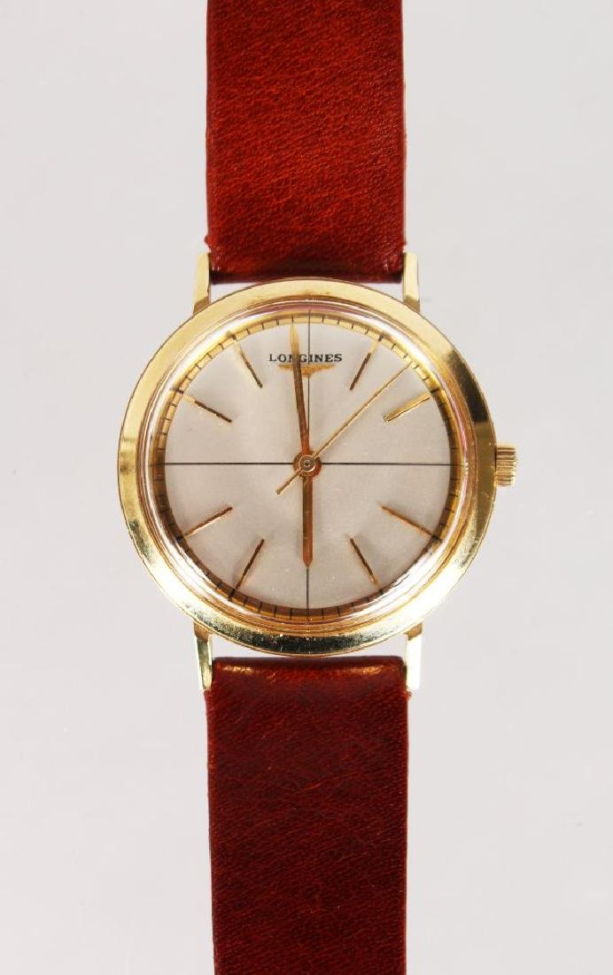 A LONGINES 14K GOLD WRIST WATCH, with leather strap
