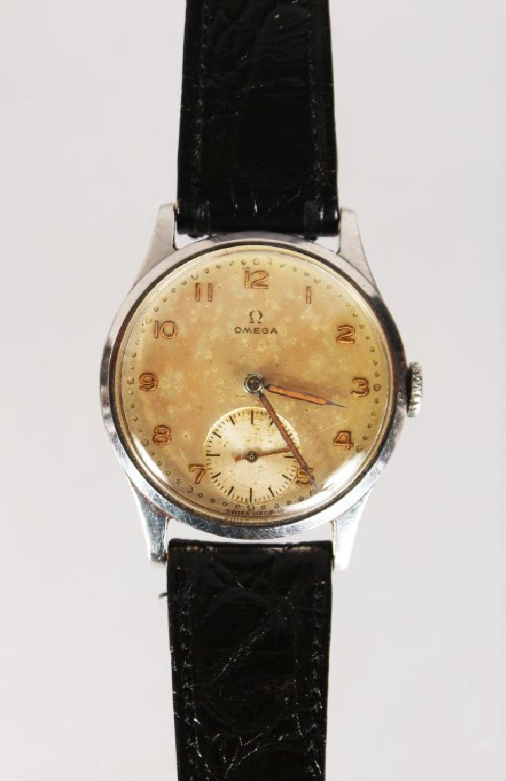 AN OMEGA WRIST WATCH, with leather strap