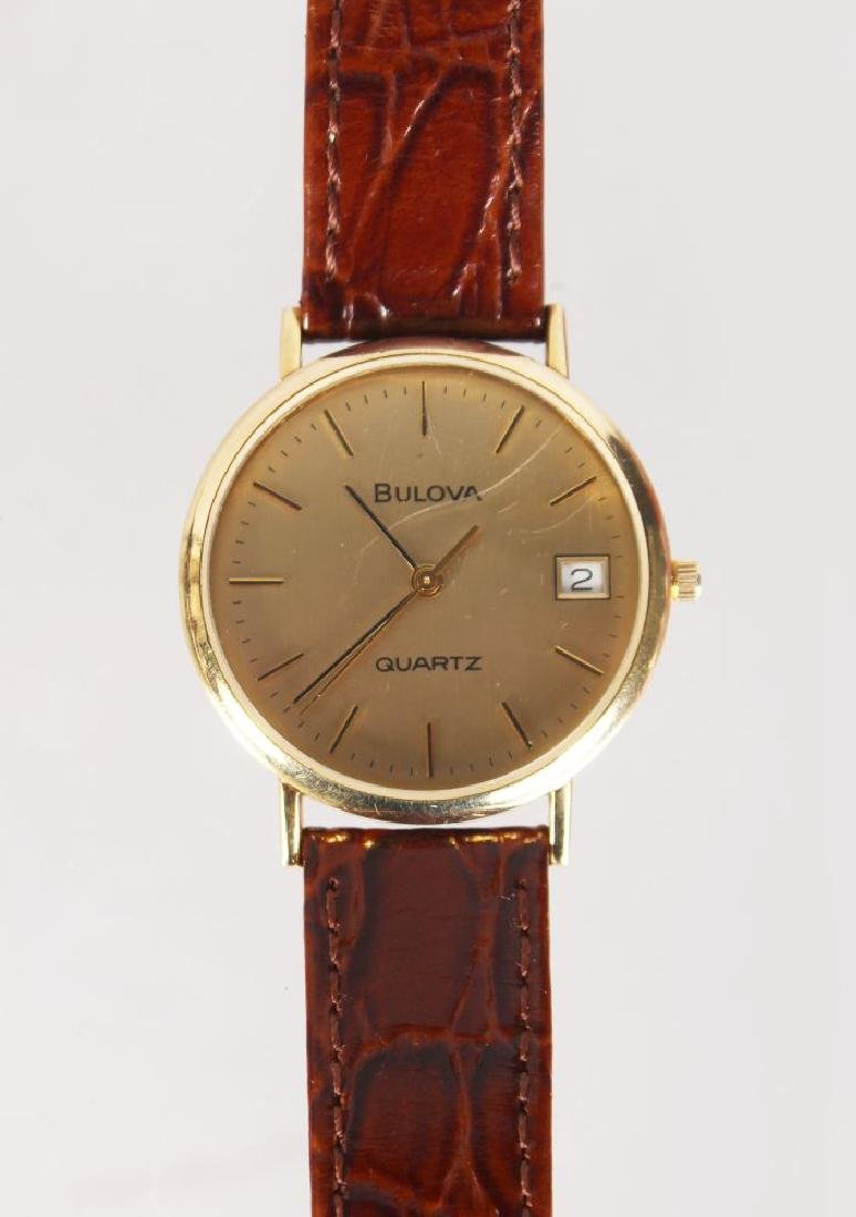 A BULOVA GOLD WRIST WATCH, with leather strap