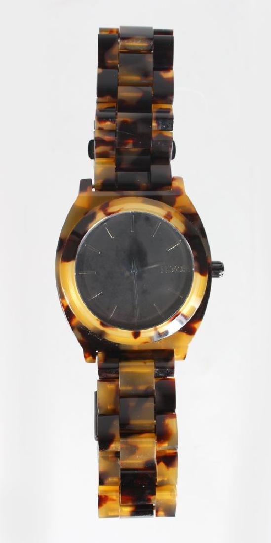 A NIXON WRIST WATCH, with faux tortoiseshell case and