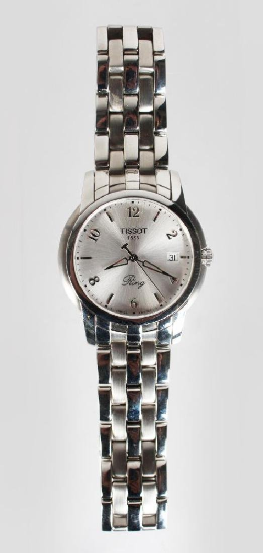 A TISSOT STAINLESS WRIST WATCH, with bracelet strap