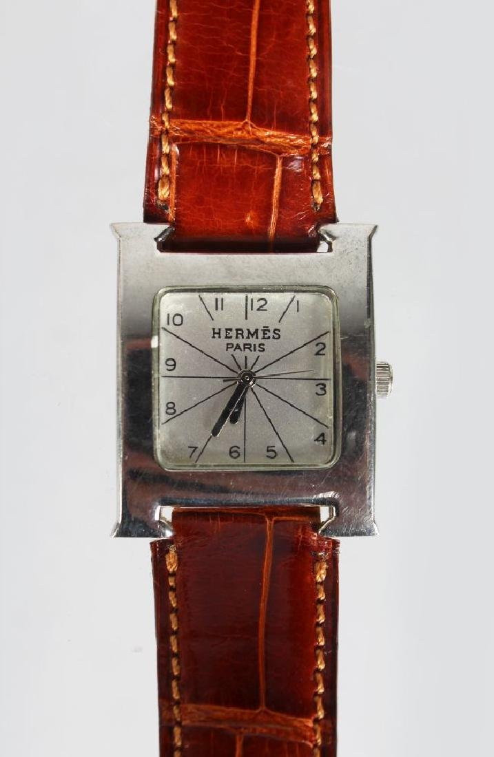 A HERMES STAINLESS STEEL WRIST WATCH,  with leather