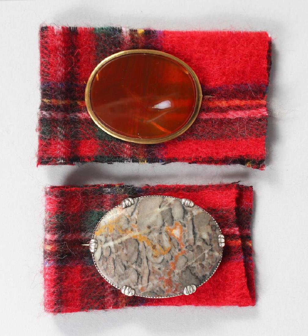 TWO SCOTTISH OVAL BROOCHES, set with agate and marble