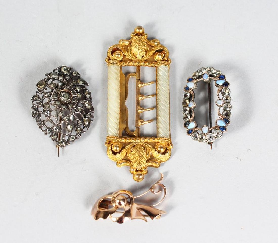 A GILT BUCKLE WITH MOTHER OF PEARL DECORATION, and
