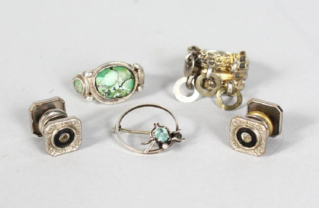 THREE SCOTTISH SILVER RINGS, and a pair of cufflinks