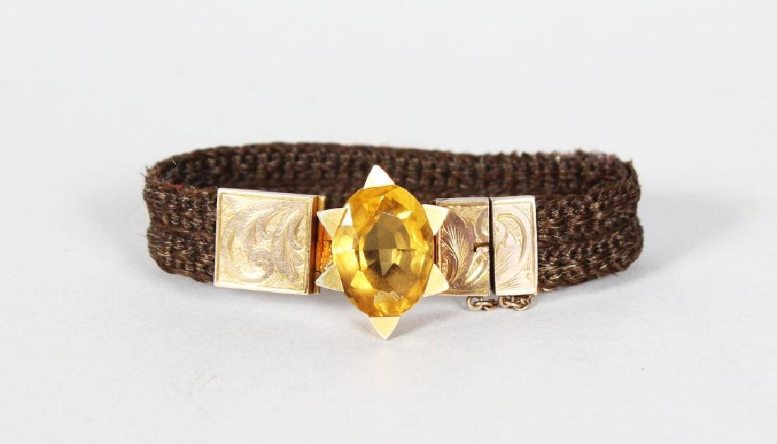 A SCOTTISH HUMAN HAIR AND GOLD MOUNTED BRACELET