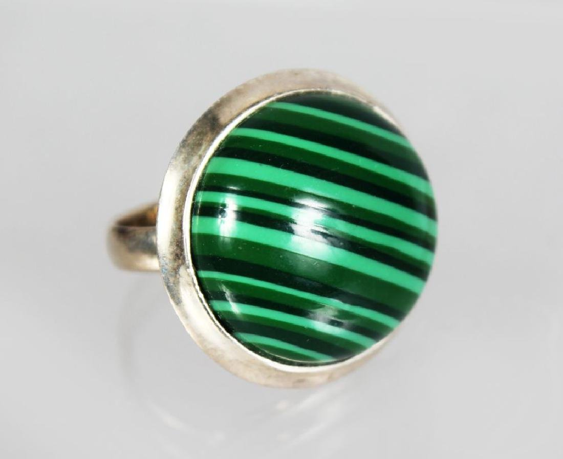 A large silver and malachite ring.