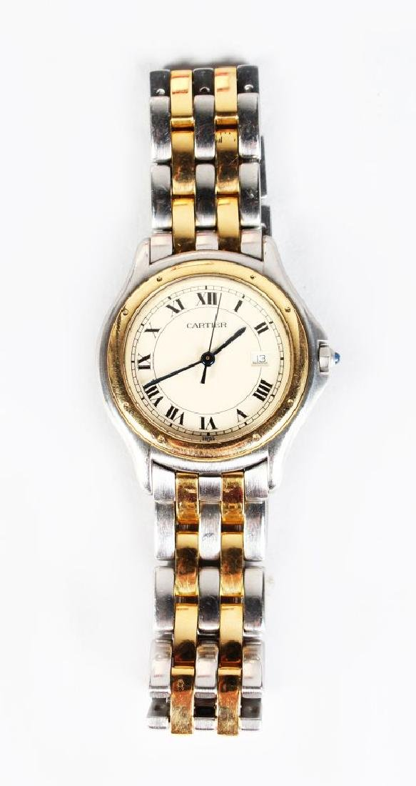 A LADIES CARTIER GOLD AND STAINLESS STEEL WRIST WATCH
