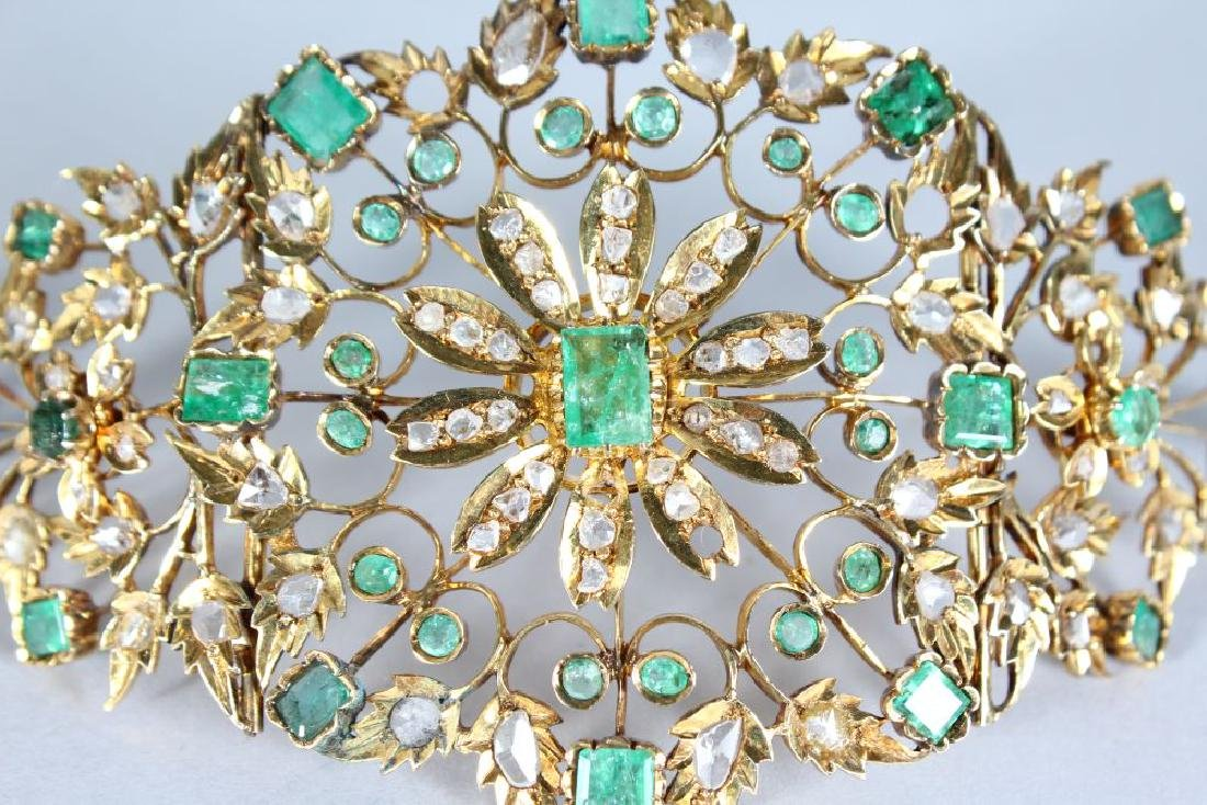 A SUBERB PAIR OF GOLD FOLDING CUFFS, set with emeralds - 2