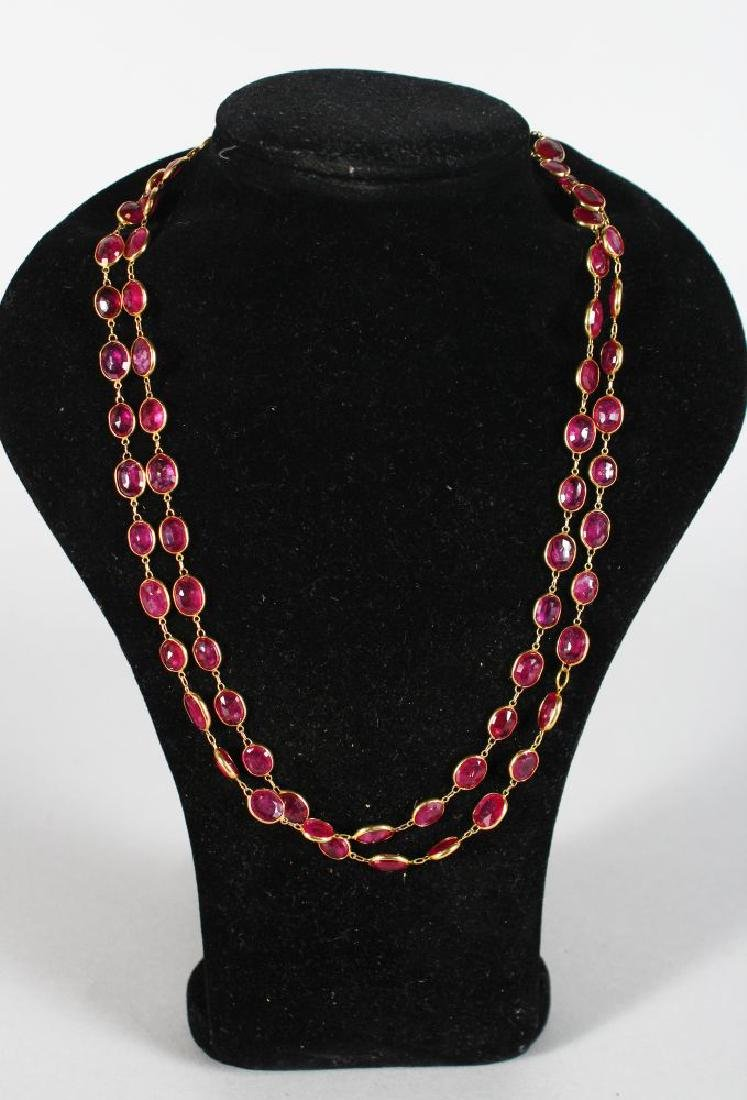 A LONG 18ct RUBY SET NECKLACE, set with 73 rubies, 38in