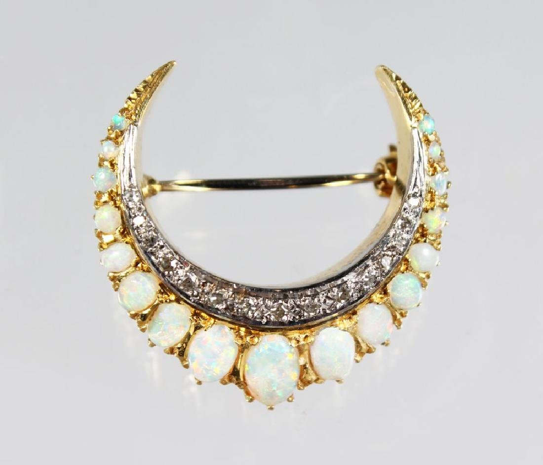AN 18ct GOLD CRESCENT SHAPED OPAL AND DIAMOND BROOCH