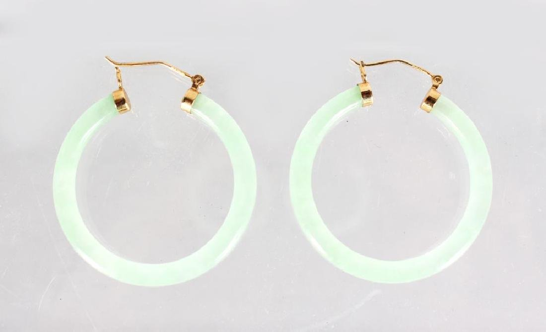 A PAIR OF 18ct GOLD MOUNTED JADE EARRINGS