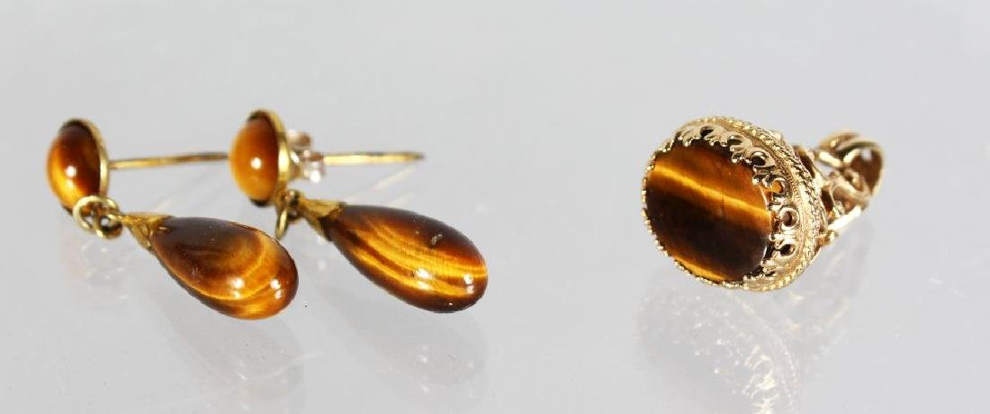 A TIGERS EYE SEAL AND EARRING