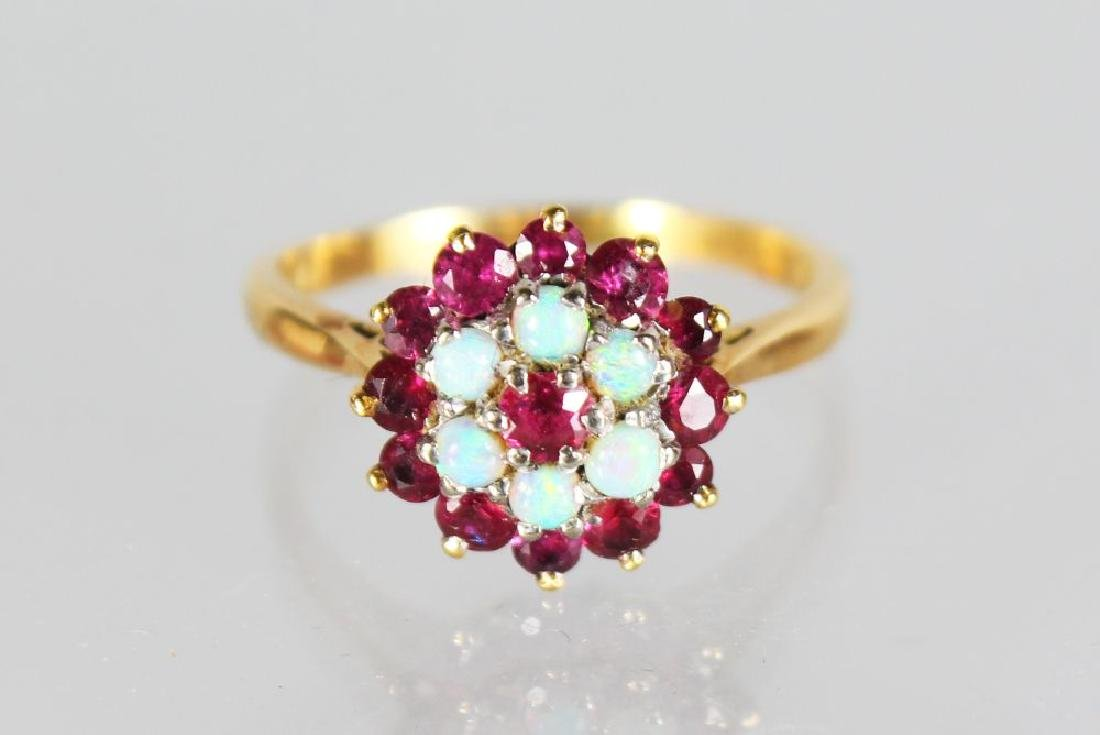 AN 18ct GOLD RUBY AND OPAL DRESS RING