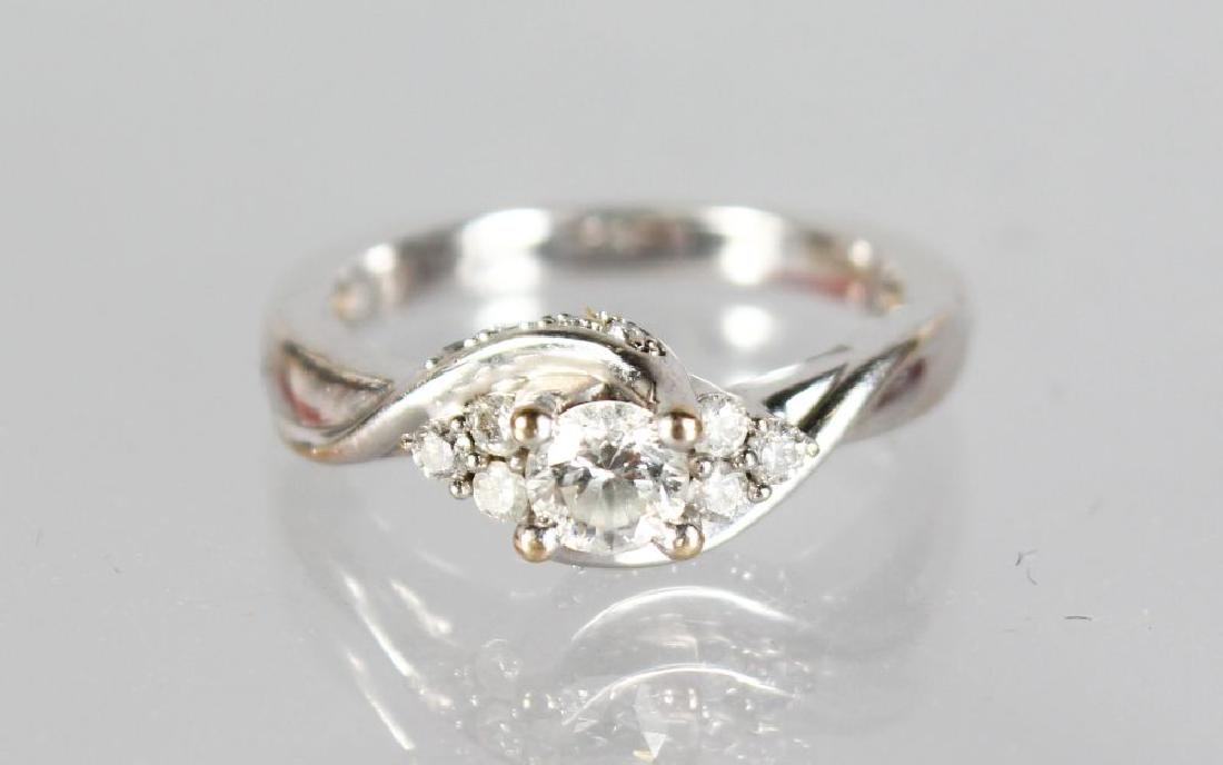A 18ct WHITE GOLD SOLITAIRE DIAMOND RING