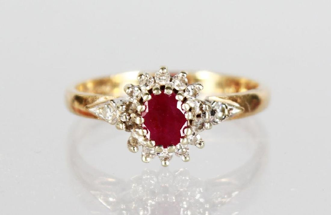 AN 18ct GOLD RUBY AND DIAMOND CLUSTER RING