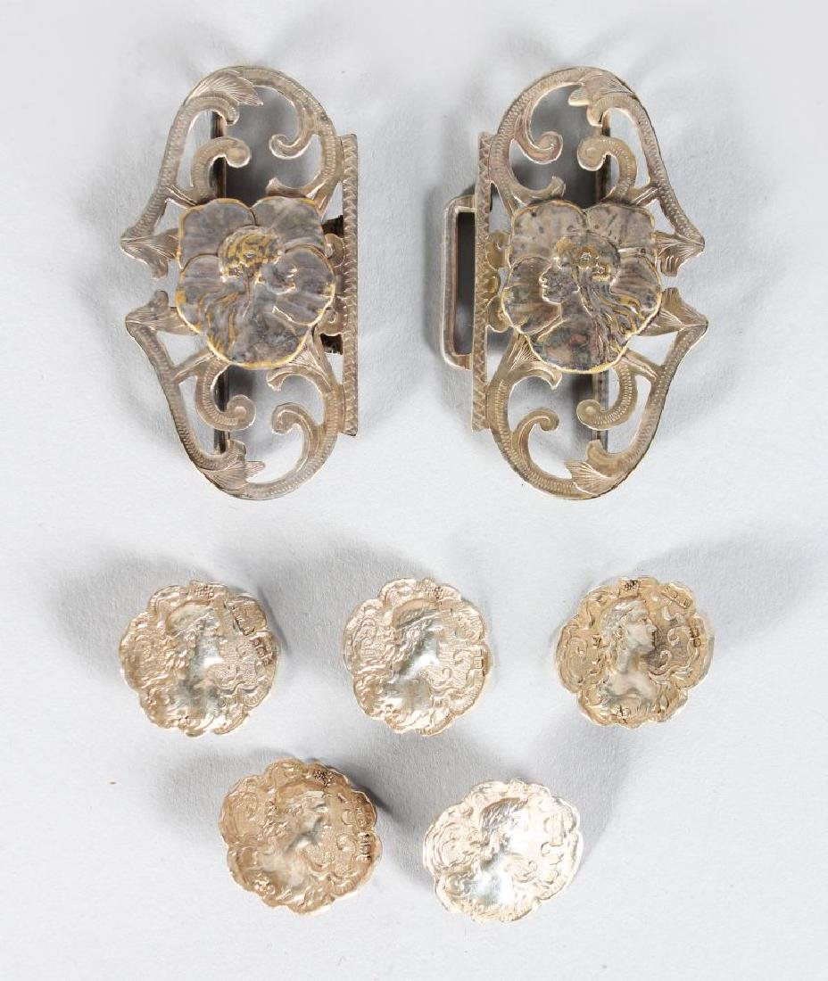 A NURSES BUCKLE AND BUTTONS
