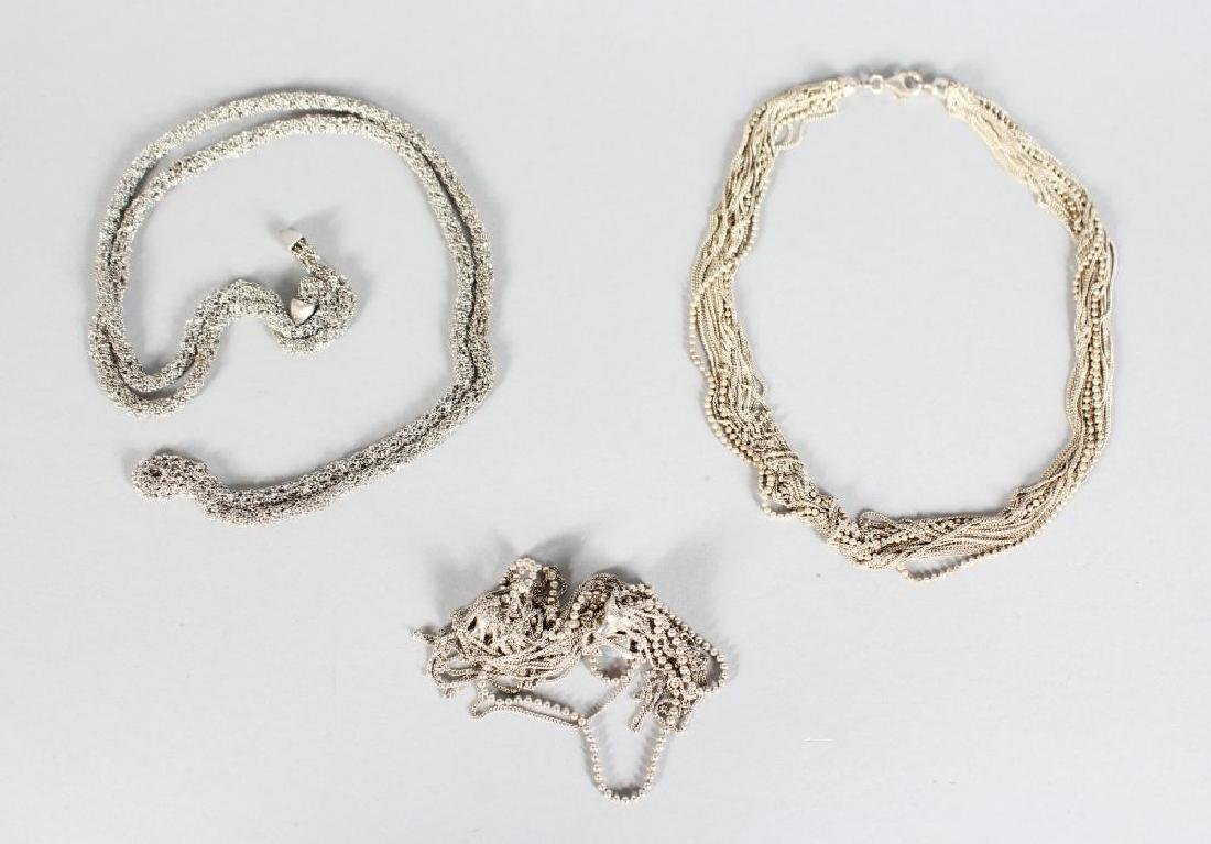 A SILVER CHAIN AND BRACELET SET