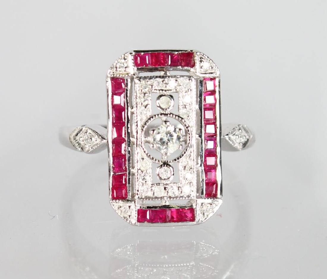 A 9ct GOLD RUBY AND DIAMOND OBLONG ART DECO STYLE RING