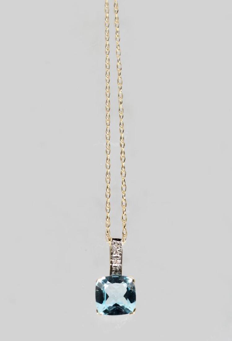 A 9ct GOLD CUSHION CUT BLUE TOPAZ AND DIAMOND PENDANT,