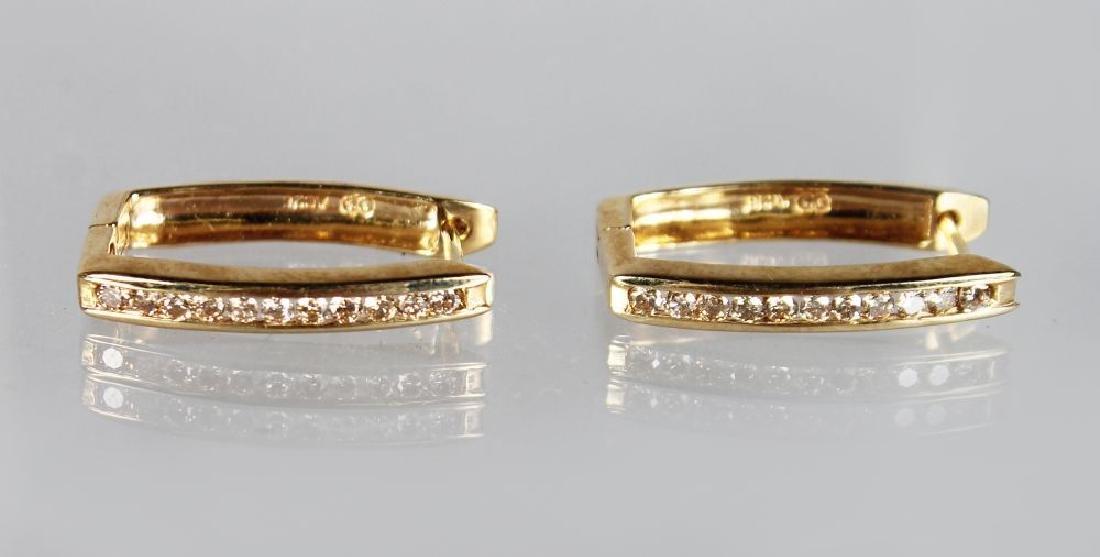A PAIR OF 9ct GOLD DIAMOND SET HALF HOOP EARRINGS