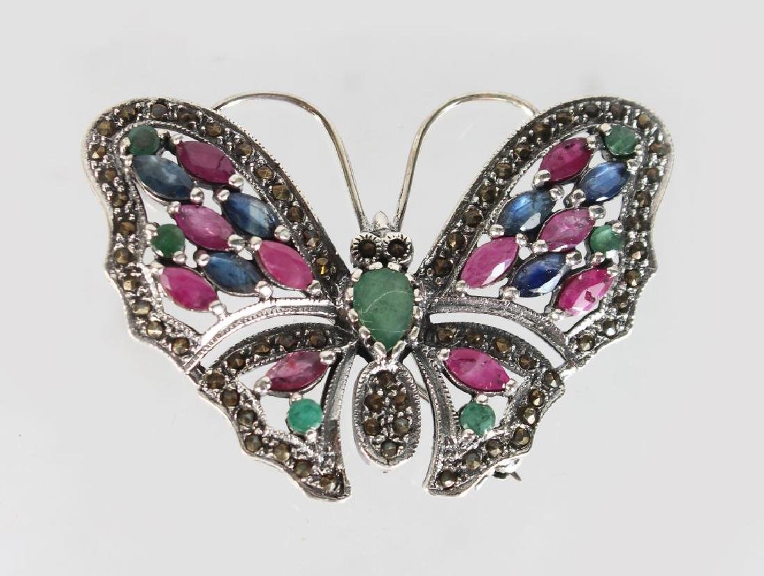 A SILVER RUBY SAPPHIRE AND EMERALD BUTTERFLY BROOCH