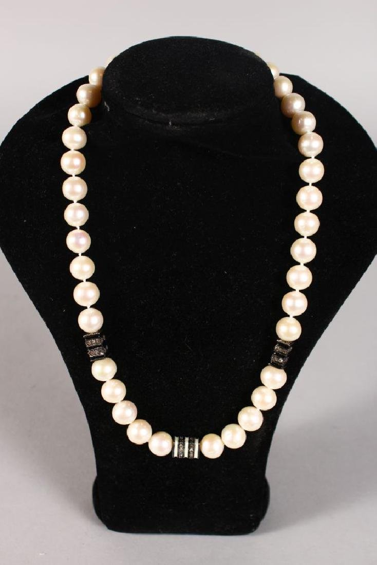 A GOLD PEARL NECKLACE with diamond section.