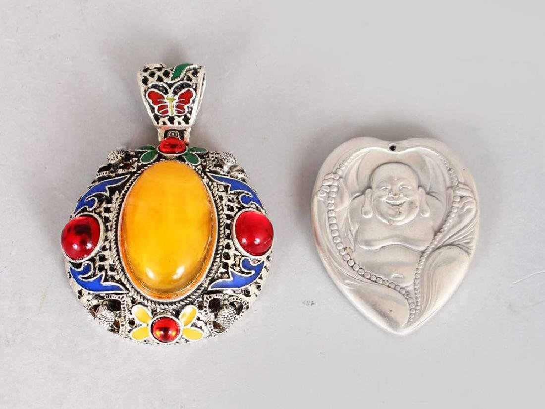 A DECORATIVE AMBER AND GEM SET PENDANT, and a Chinese