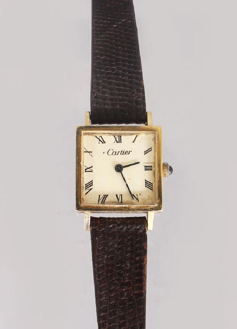 A LADIES GOLD CARTIER WRISTWATCH, with square dial,